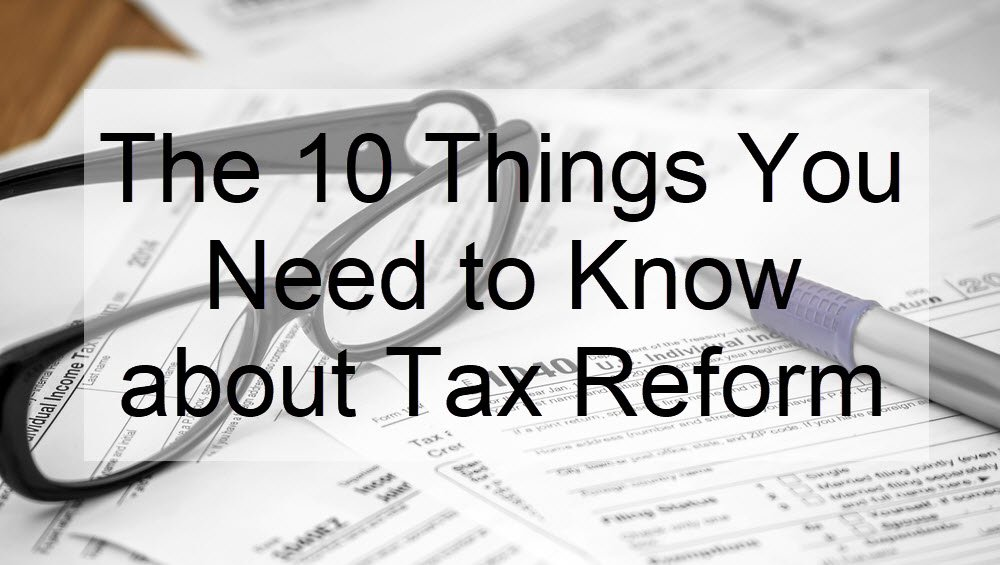 Black text on a transparent white background. Text reads 'The 10 things you need to know about tax reform.' the white box is in front of some tax paper work with reading glasses.